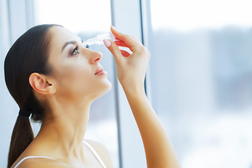 Health and Beauty. Eye Care. Beautiful Young Woman Holding Drops For Eyes. Good Vision. Happy Girl with Fresh Look.